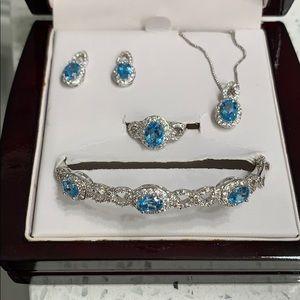 Jewelry - NWT 4 piece blue topaz jewelry set